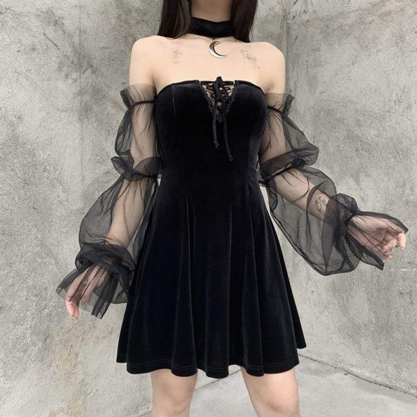 Dámské černé volné šaty s volánky